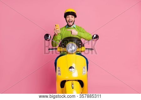 Portrait Of His He Nice Attractive Glad Cheerful Cheery Guy Riding Motorbike Showing Cell Fast Speed