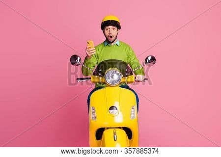 Portrait Of His He Nice Attractive Amazed Funny Cheerful Guy Riding Motorbike Using Cell Reading Blo