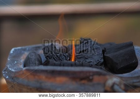Burning Charcoal On  Charcoal Grill Earthenware For Grilling At A Outdoor Party