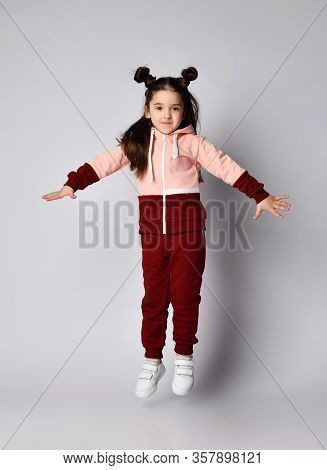 Frolic Curious Kid Girl With Straight Brunette Hair With Buns In Modern Fashion Pink Brown Sportwear