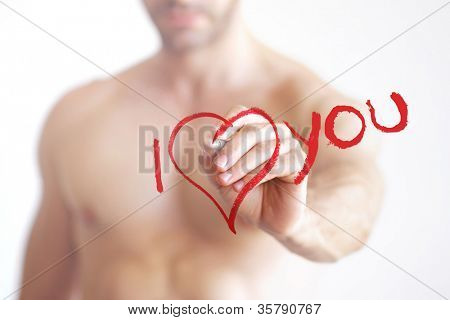 "Sexy naked man writing ""I love you"" with heart symbol in red on transparent board"