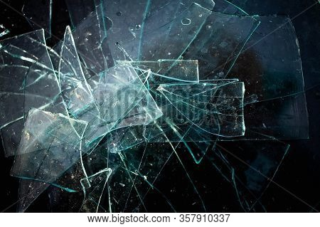 Broken Glass Pile Pieces Texture And Black Background.