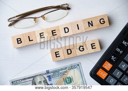 Modern Business Buzzword - Bleeding Edge. Top View On Wooden Table With Blocks. Top View. Close Up.