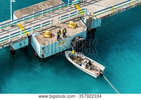 Ocho Rios, Jamaica - April 22, 2019: Mooring Gang And Motorboat With Rope Of Ship During Mooring Ope