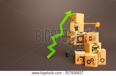 Shopping Cart With Boxes And Green Up Arrow. Growth Trade Production, Increased Sales Rate. Improvin