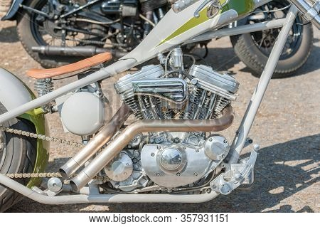 Chromed Custom Motorcycle Engine And Exhaust Pipe Closeup