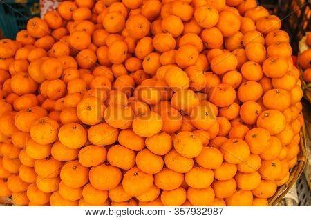 Fresh Picked Mandarins. Fresh Mandarin Oranges Fruit Or Tangerines. Mandarins Sell On A Food Market.