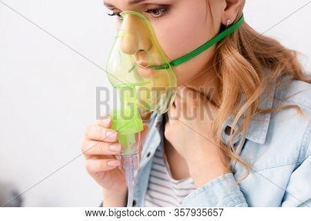 Asthmatic Woman Holding Respiratory Mask Near Face