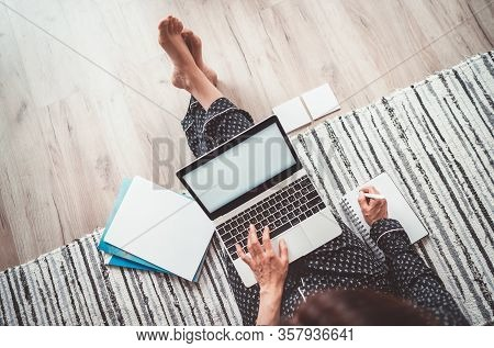 Business Woman Barefoot Dressed Pajamas Writing Notes Sitting On Living Room Floor Office With Lapto