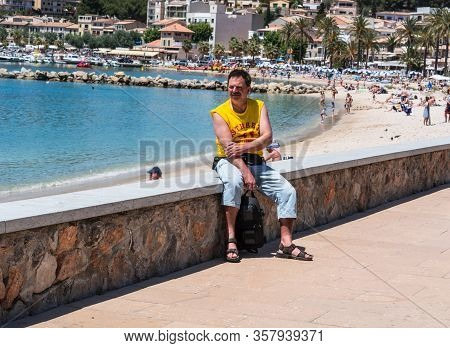 Paguera, Mallorca, Spain - July 02, 2016: Paguera, Mallorca, Spain - July 02, 2016: A Man Sitting In