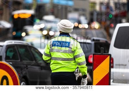 Romanian Police (politia Rutiera) Directing Traffic And Patrolling Streets To Avoid Curfew Breaches