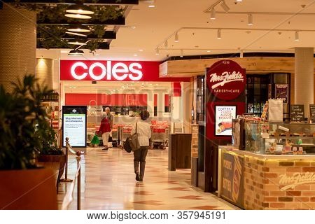 Sydney, Australia 2020-03-24 Entrance To Coles Supermarket And Coronavirus Information Sign At Westf