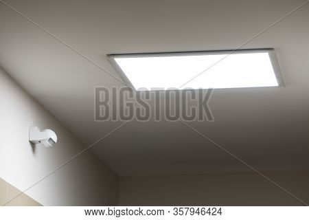 Large Led Lighting Panel On The Ceiling In A Modern Residential Complex. Power Saving. Motion Sensor