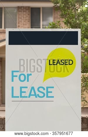 For Lease And Leased Sign On A White Display Outside Of A Resedential Building