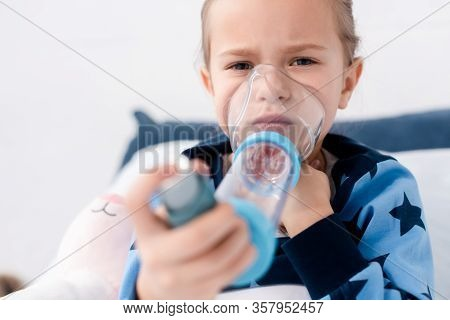 Selective Focus Of Asthmatic Child Using Inhaler With Spacer