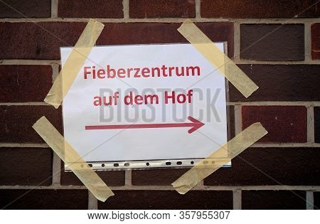Sign In Germany With The Inscription Corona Test Centre (fieberzentrum) On The Courtyard