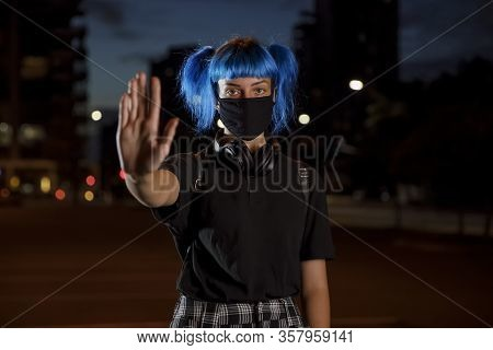 Stop Coronavirus Social Distancing Concept, Young Female With Blue Hair Wearing A Stylish Protective