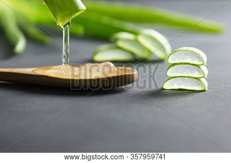Aloe Vera Gel Close-up. Sliced Aloe Vera Plants Leaf And Gel With Wooden Spoon , Natural Organic Cos