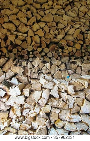 Stacks Of Firewood. Firewood Background. Background Of Dry Chopped Firewood. Wooden Background