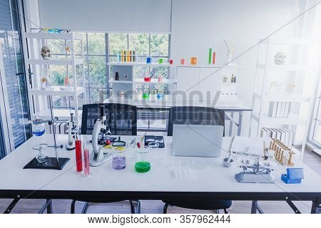 Laptops, Smartphones, Microscopes, Beakers, Test Tubes, And Scientific Laboratory Equipment In Scien