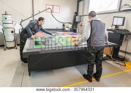 Two Technicians Works On Cnc Computer Numerical Control Cutting Machine