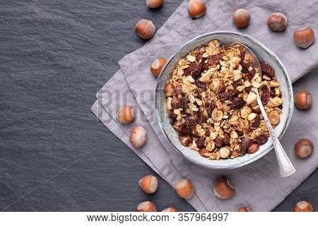Homemade granola with nuts, raisins and seeds in bowls, good choice for breakfast or healthy snack