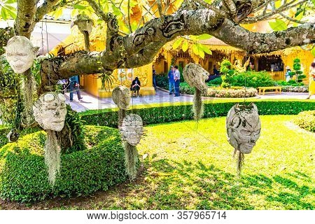Chiang Rai, Thailand - 6.11.2019: Sculpted Stone Heads Hanging From A Tree At Wat Rong Khun, The Whi