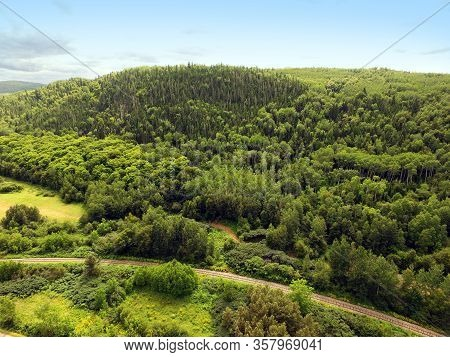 Beautiful Aerial View Of Forest Mountain With Railway