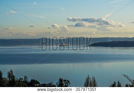 A Ship Moves Acroos The Puget Sound On Smoothe Water.