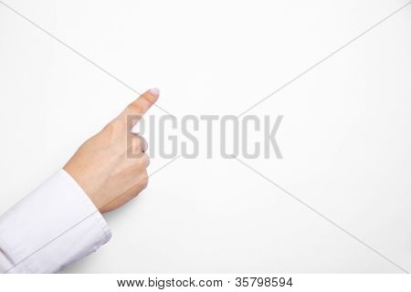 Female index finger pointing on empty white flipchart paper