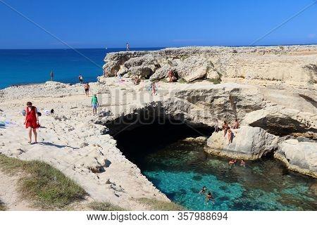 Salento, Italy - June 1, 2017: People Visit Grotta Della Poesia Swimming Cave In Roca, Salento Penin