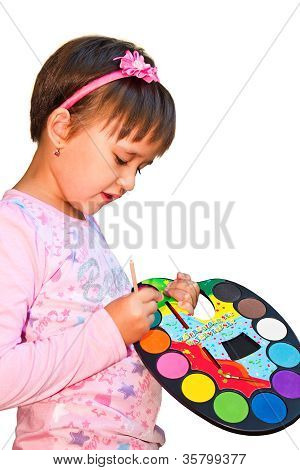 Young artist with paints in hand