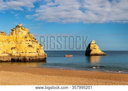 Lagos, Portugal - 4 March 2020: Lagos Coastline In Portugal, Dona Ana Beach At Sunset