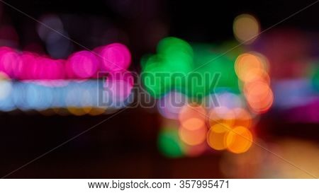 Colorful blurred bokeh lights at night at a fun fair or a fair