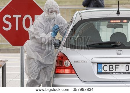 Vilnius, Lithuania, March 19, 2020. Medical Staff In Protective Gear Collects Samples For Covid-19 C