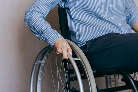 Unrecognizable Disabled Woman In Wheelchair At Home. Recovery And Healthcare Concepts.