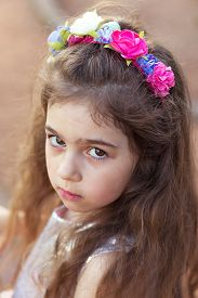 Portrait Of Cute Sad Little Girl Looking Sad At Summer Day