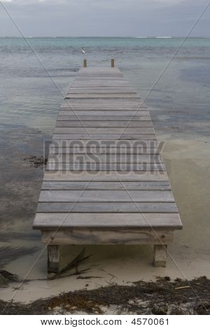 Small Pier And Calm Water