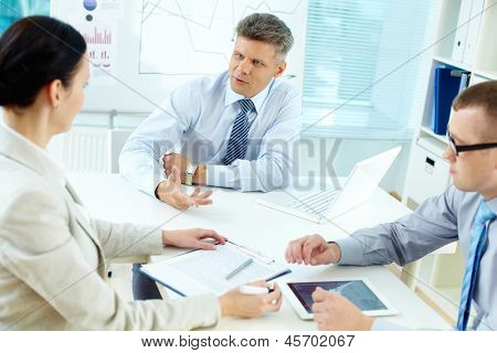 Portrait of business team discussing new project