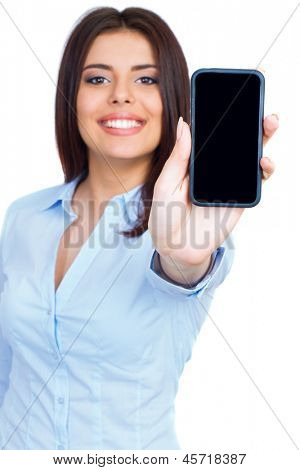Young woman showing display of mobile cell phone with black screen and smiling on a white background. Focus on hand.