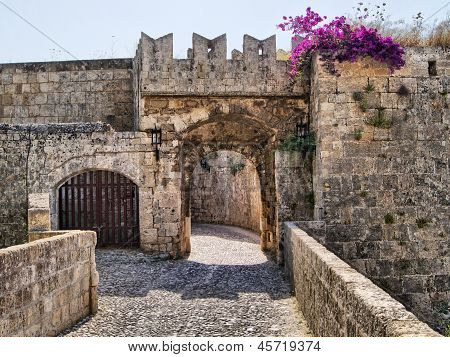 Medieval defensive gate in the fortifications of Rhodes Old Town, Greece poster