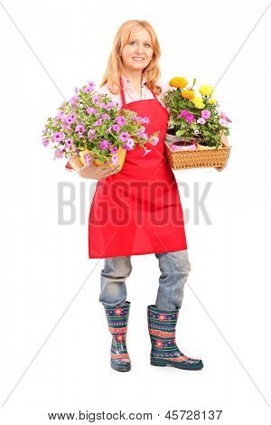 Full length portrait of a middle aged female florist holding flowers isolated on white background