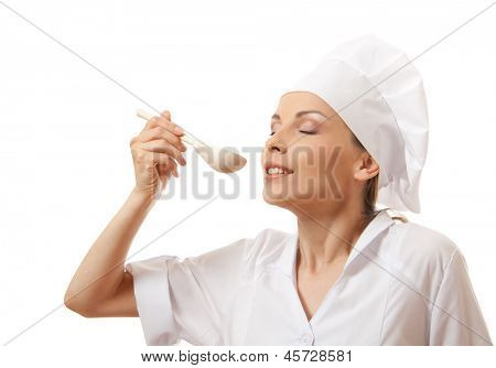 Woman cook eating with spoon, isolated on white background