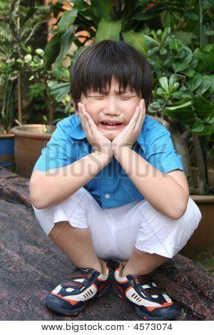 Sad Boy Squatting