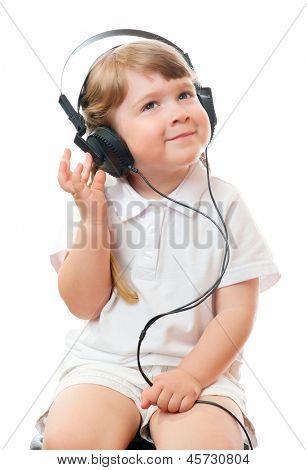 little girl listens music in ear-phones