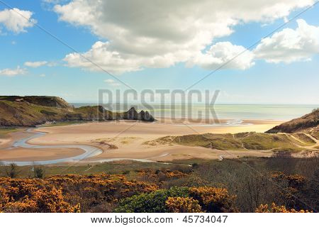 A view of Three Cliffs Bay on the Gower Peninsula in South Wales, UK poster