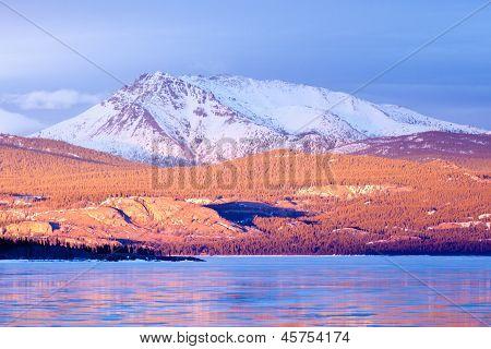 Snowy Mt Laurier frozen Lake Laberge Yukon Canada