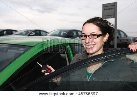 Happy Young Woman Buying a Car