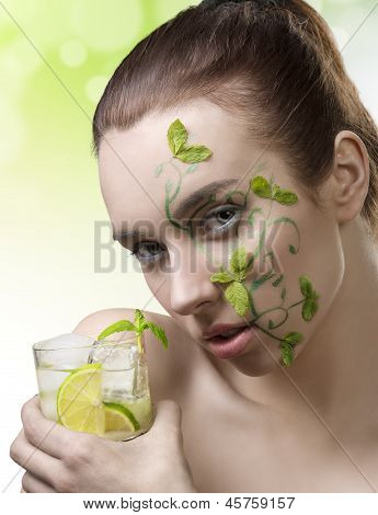 Cute Girl With Fresh Make-up Drinking Cocktail