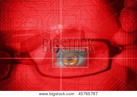 Woman having an eye analysed with red circuit board on the background